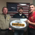 Precision Pipeline Donation : Cpt. Pennock (left) Sheriff Petty (right) Cody Roundcount (Precision Rep), (Center)